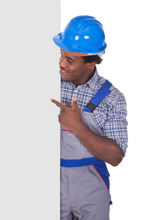 Craftsman Behind Placard Showing Thumb Up Sign Over White Background photo