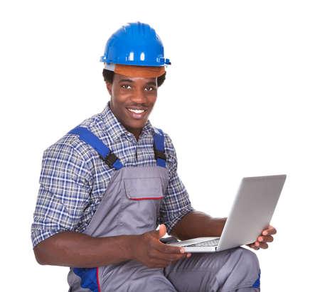 mechanical men: Happy Craftsman Holding Laptop Over White Background