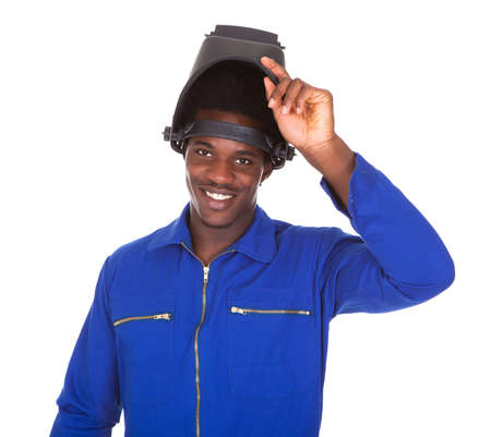 Portrait Of Happy Male Welder Standing Over White Background photo