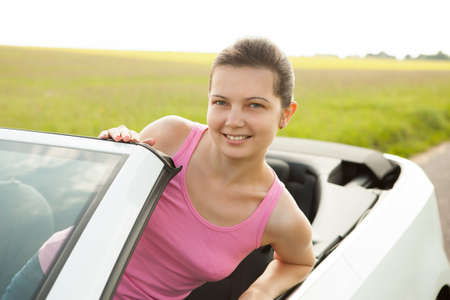 cabrio: Young Woman Leaning On Windshield Of Roofless