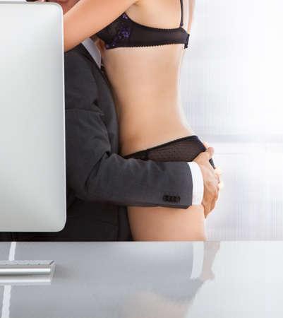 man and woman sex: Портрет пара занимается сексом в офисе Фото со стока