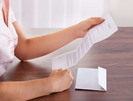 mails: Closeup Of Young Businesswoman Holding Envelope With Letter