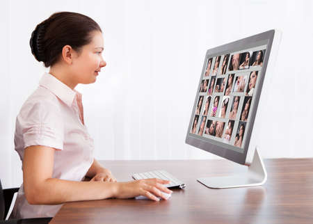 Happy Professional Designer Woman Editing Images In Office photo