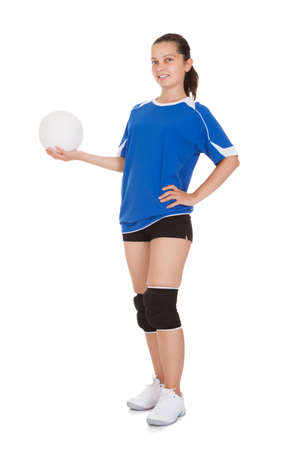 female volleyball: Happy female volleyball player holding ball on white background