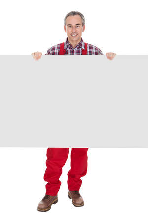 Technician Holding Blank Placard On White Background photo