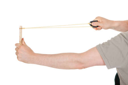 stretched: Close-up of hand pulling sling shot on white background