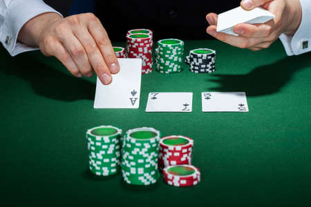 croupier: Close-up of croupier arranging cards on table