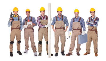 Group Of Happy Workers Holding Equipment Over White Background photo