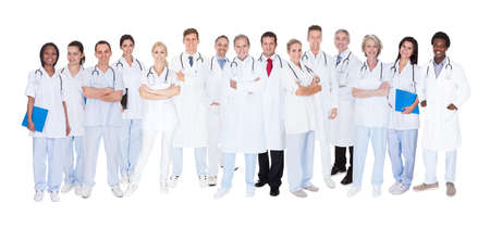 Group Of Smiling Doctors With Stethoscopes Over White Background photo