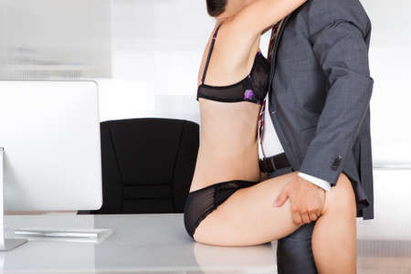 erotic couple: Portrait of a couple having sex in office