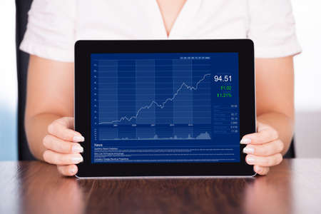 Close-up Of Young Businesswoman Presenting Graph On Digital Tablet Stock Photo - 22062435