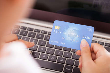 Close-up Of Female Hand With Credit Card Shopping Online photo