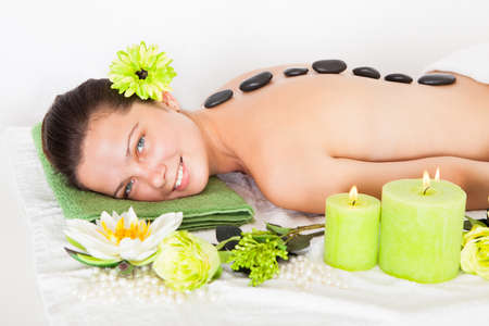 Young Happy Woman Getting Lastone Massage In Spa photo