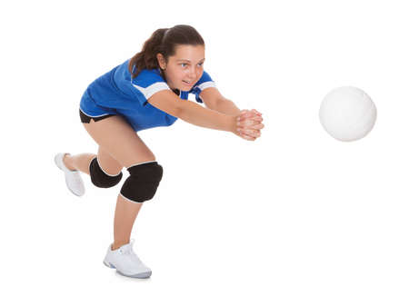 Portrait of female volleyball player isolated on white background Stock Photo