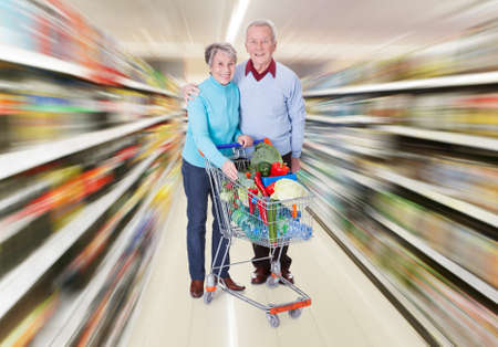 Portrait Of Happy Senior Couple Shopping Fresh Vegetables Stock Photo - 22162755
