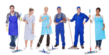 Multi Racial Group Of Cleaners Holding Mop Over White Background photo