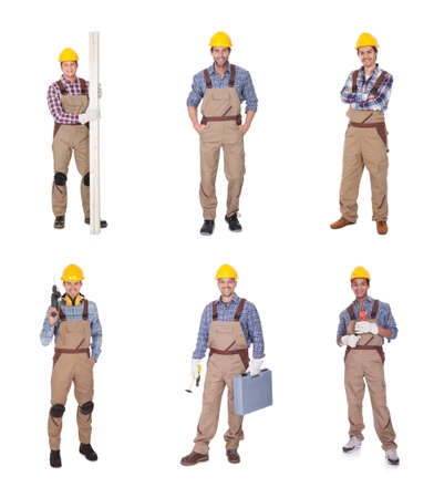 Group Of Happy Workers Holding Equipment Over White Background Stock Photo - 22381846