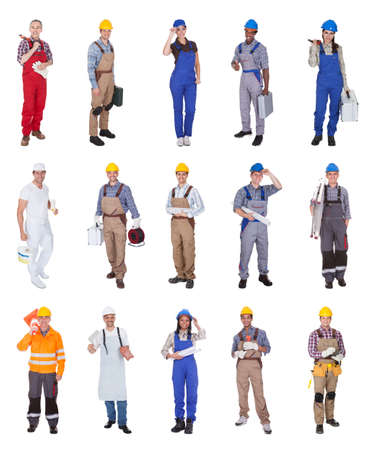 Group Of Construction Workers Standing Over White Background photo