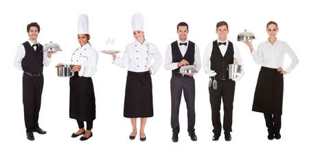 butler: Young Group Of Waiters And Waitress Over White Background Stock Photo