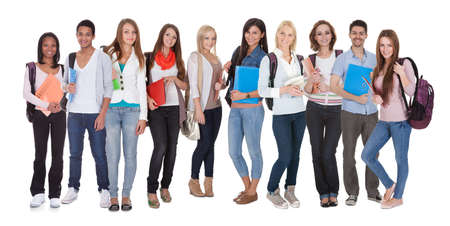 handsome student: Young Multi Racial Of Group Of Students Standing Over White Background Stock Photo