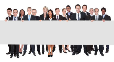 publicity: Happy Group Of Businesspeople Holding Placard Over White Background