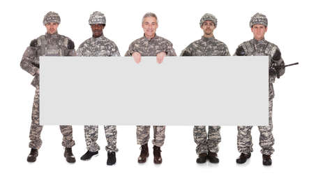 Group Of Soldier With Blank Placard Over White Background photo