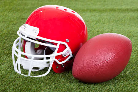 Close-up Of A Red Football Helmet On Field photo