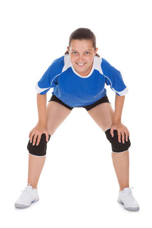 Portrait of a happy female Volleyball player over white background photo