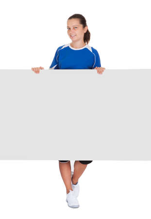 Happy young woman holding blank placard on white background photo