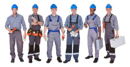 Group Of Happy Plumber Holding Tools isolated over white photo