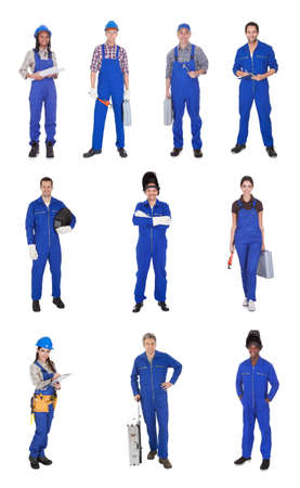 Group Of Industrial Workers Standing Over White Background photo