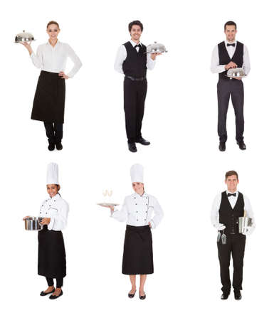 Young Group Of Waiters And Waitress isolated over white Stock Photo