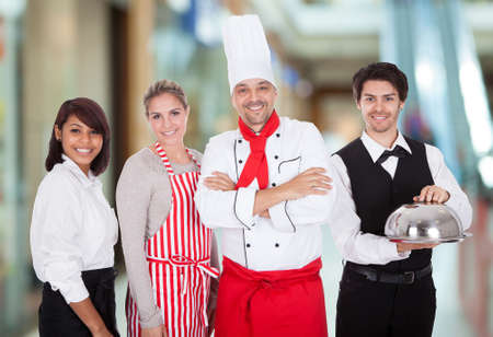 Happy Group Of Restaurant Staff Smiling Indoor photo