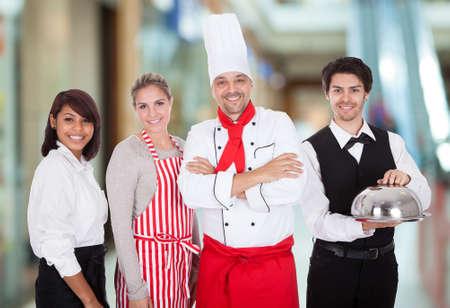 Happy Group Of Restaurant Staff Smiling Indoor