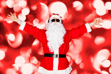 Portrait Of A Santa Listening Music And Gesturing photo