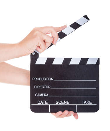 Close-up Of Hand Holding Clapperboard isolated on white