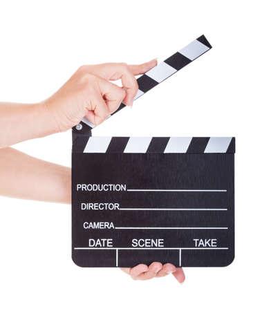 Close-up van de hand houden Clapperboard geïsoleerd op wit Stockfoto