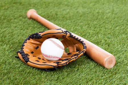 size: Leather Glove With Baseball And Bat On Green Pitch