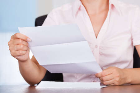 Closeup Of Young Businesswoman Holding Envelope With Letter photo