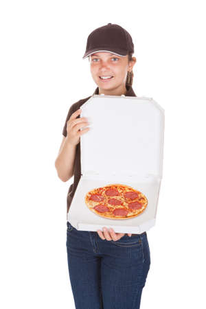 Young delivery woman holding opened pizza box photo