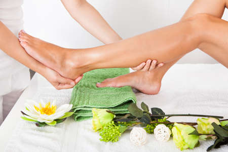 Close-up Of Woman Feet Receiving Foot Massage In Spa photo