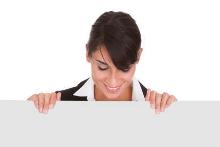 Happy Businesswoman Holding Blank Placard Over White Background Stock Photo - 22752962