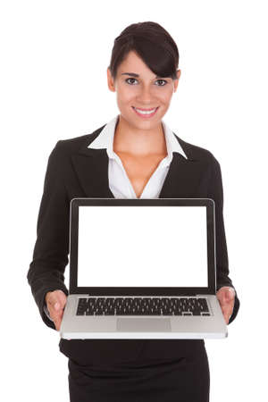 Happy Businesswoman Showing Laptop Over White Background Stock Photo - 22752963