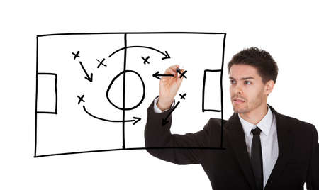 Man writing football game strategy on white screen photo
