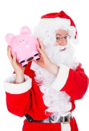 Santa holding piggy bank on white background photo