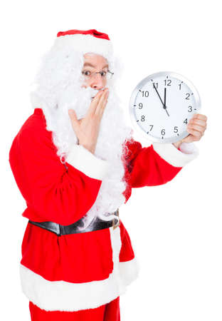 Santa Pointing At Clock Showing Time Over White Background photo