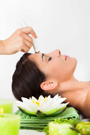 Young Woman Getting A Face Treatment In A Beauty Spa photo