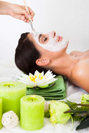 chemical peels: Young Woman Getting A Face Treatment In A Beauty Spa