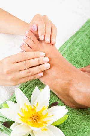 natural therapy: Close-up Of Woman Feet Receiving Foot Massage In Spa