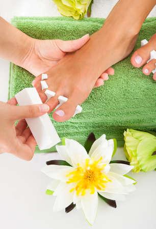 manicurist: Close-up Of Manicurist Filing A Female Nails In A Beauty Salon